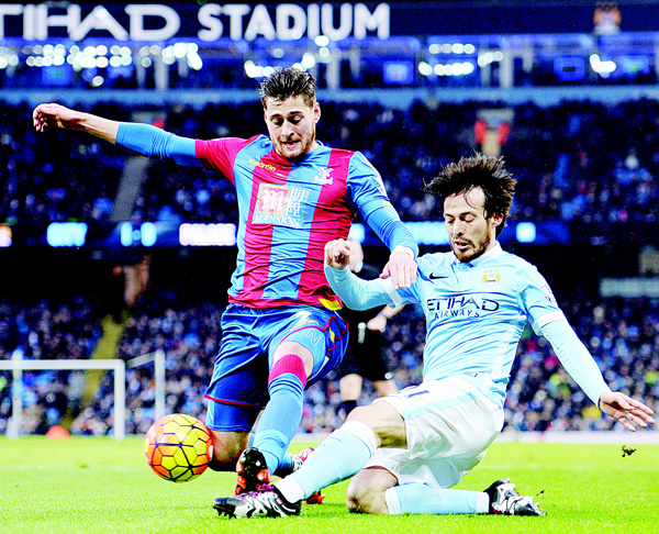 Crystal Palace's English defender Joel Ward (left), vies with Manchester City's Belgian midfielder Kevin De Bruyne during the English Premier League football match between Manchester City and Crystal Palace at the Etihad Stadium in Manchester, north west England on Jan 16. (AFP)