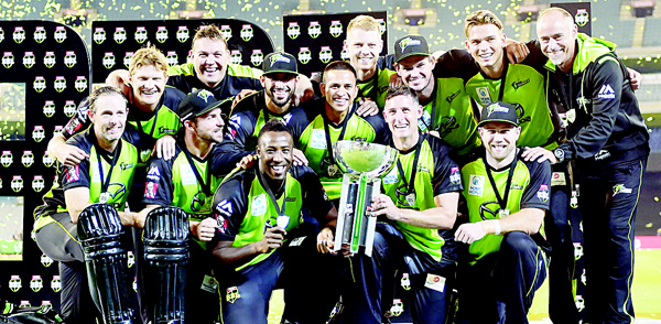 Sydney Thunder players celebrate winning the T20 Big Bash League cricket final between the Melbourne Stars and Sydney Thunder at the Melbourne Cricket Ground (MCG) in Melbourne on Jan 24. (AFP)