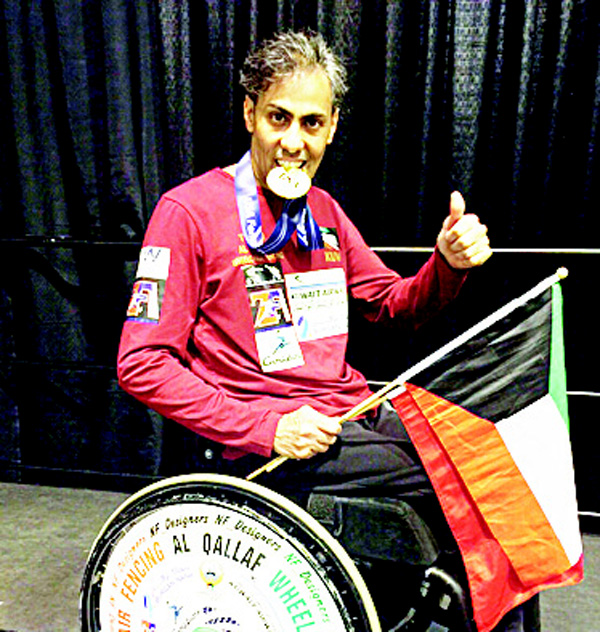Kuwait's athlete Tareq Al-Qallaf poses with his medal after winning the men's wheelchair Epee Division at the North American Cup.