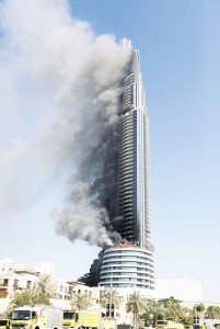 A fire burns on the Address Downtown skyscraper in Dubai, UAE on Jan 1. The blaze began Thursday night before Dubai's annual New Year's Eve fireworks show at the Burj Khalifa, the world's tallest building which sits nearby. (AP)