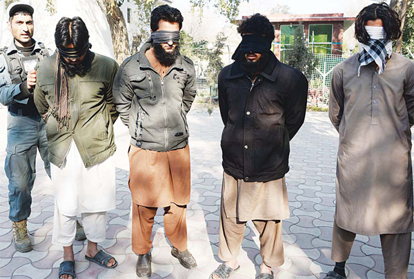 Alleged fi ghters for Islamic State (IS) stand handcuffed while being presented to the media at a police headquarter in Jalalabad, Nangarhar province on Jan 20. Afghan police said they arrested four alleged Islamic State fi ghters and two Taleban militants with their weapons during an operation in Behsood district of Nangarhar province. (AFP)