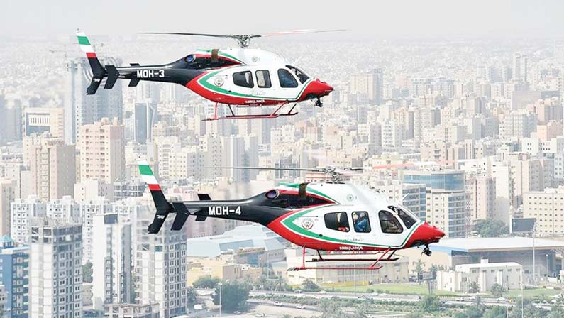 Air ambulance helicopters flying over a densely populated area in Kuwait