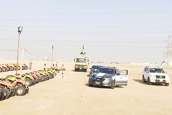 Police cars at the place where dune-buggies are rented out to campers in the desert