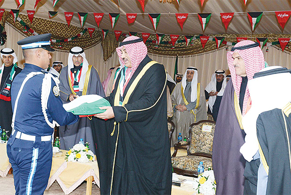 First Deputy Prime Minister and Minister of Foreign Affairs Sheikh Sabah Al-Khalid Al-Hamad Al-Sabah is presented with Kuwait's fl ag during the ceremony to mark inauguration of Independence and Liberation festivities.