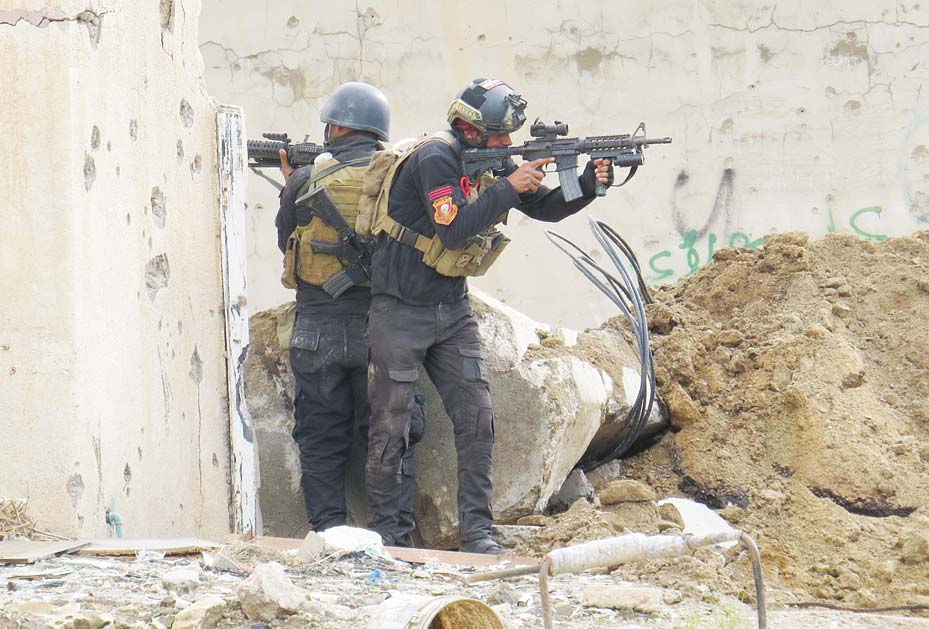 Iraqi forces secure an area near the Grand Mosque in central Ramadi, the capital of Iraq's Anbar province, on Jan 8, after retaking the city from Islamic State (IS) group jihadists. (AFP