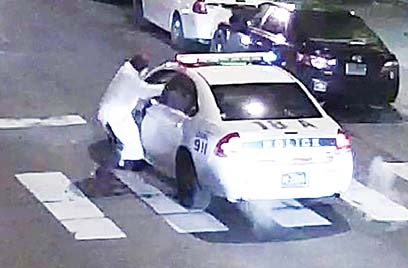 This video still image obtained Jan 8, courtesy of the Philadelphiia Police Department, shows a shooting suspect and police car on Jan 7, in Philadelphia, PA. (Inset): This handout photo obtained Jan 8, courtesy of the Philadelphia Police Department, shows shooting suspect Edward Archer, 30, in Philadelphia, PA. (AFP)