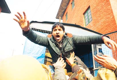 A Kashmiri Shiite Muslim shout slogans as he was detained during a protest against Saudi Arabia in Srinagar, Indian controlled Kashmir on Jan 3.