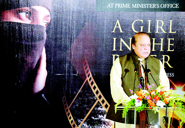 In this handout photograph released by the Pakistan Press Information Department (PID) on Feb 22, Pakistan's Prime Minister Nawaz Sharif speaks during a screening of 'A Girl in the River: the Price of Forgiveness' by Pakistani film-maker Sharmeen Obaid Chinoy at Prime Minister's Office in Islamabad. (AFP)