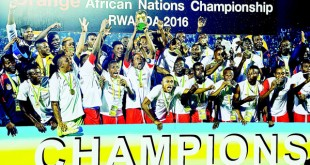 DR Congo's players celebrate with the trophy after winning the 2016 African Nations Championship (CHAN) final football match against Mali at Amahoro National Stadium in Kigali on Feb 7. DR Congo won by 3-0. (AFP)