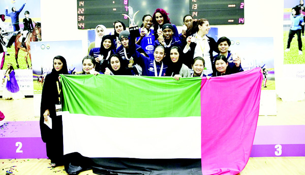 Group photo of the Sharjah Ladies Club team during the coronation after the final basketball game with the Jordanian Orthodox Club.