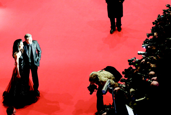 US actor George Clooney (second from left) and his wife Amal Clooney pose for a photograph at the red carpet for 'Hail, Caesar!' the opening film of the 2016 Berlinale Film Festival in Berlin, Germany on  Feb 11. (AP)