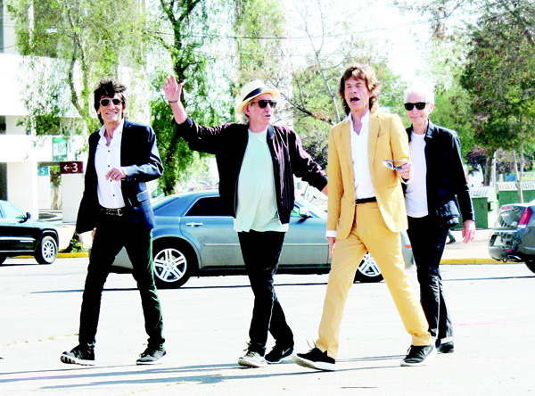 British Rolling Stones' (left to right), Ronnie Wood, Keith Richards, Mick Jagger and Charlie Watts arrive to the National Stadium in Santiago on Feb 1, for a sound test. (AFP)