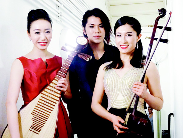 Pipa player Jiaju Shen (left), composer and pianist Li Zong (center), and huqin player Feifei Yang (right), pose for a picture before a performance at Carnegie Hall in New York City. The young Chinese-born, New York-based artists are trying to explore new musical frontiers through modern compositions on traditional Chinese instruments. (AFP)
