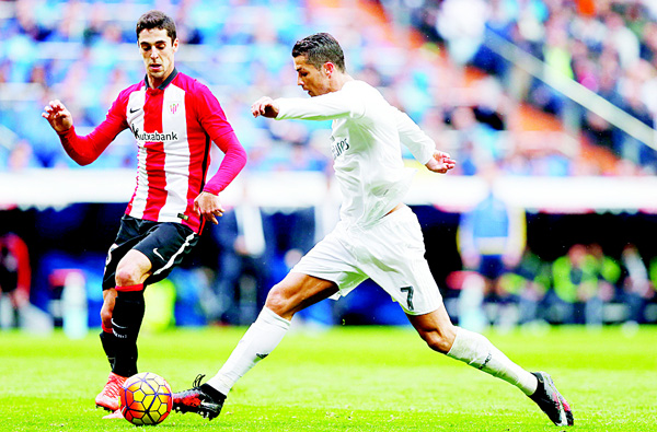 Real Madrid's Cristiano Ronaldo (right), duels for the ball with Athletic Bilbao's Sabin Merino during a Spanish La Liga soccer match between Real Madrid and Athletic Bilbao at the Santiago Bernabeu stadium in Madrid, Spain, on Feb 13. (AP)