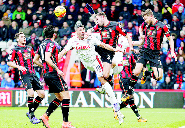 AFC Bournemouth's Simon Francis (right), and Steve Cook (second right), battle for the ball with Stoke City's Jonathan Walters during the English Premier League soccer match at the Vitality Stadium, Bournemouth, England on Feb 13. (AP)