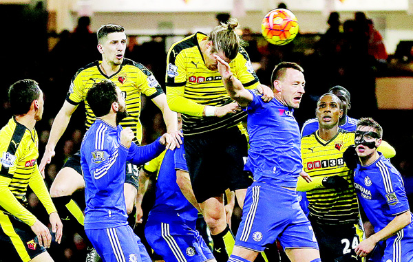 Watford's Sabastian Proedl (center), heads the ball during the English Premier League soccer match between Watford and Chelsea at the Vicarage Road Stadium in London, on Feb 3. (AP)
