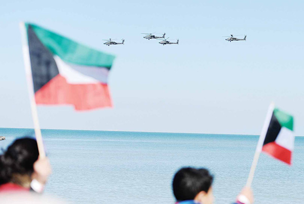 Helicopters from Kuwait's Air Force flying high during national celebrations.