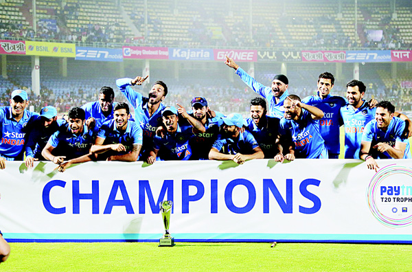 Members of the Indian cricket team celebrate with the winning trophy after their Twenty20 cricket series win against Sri Lanka, in Vishakapatnam, India, on Feb 14. (AP)