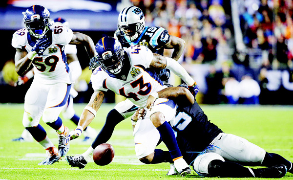 Denver Broncos' T.J. Ward (43) fumbles after making an interception during the second half of the NFL Super Bowl 50 football game on Feb 7, in Santa Clara, California. (AP)