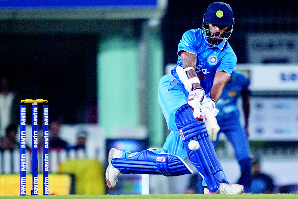 Indian batsman Shikhar Dhawan plays a ball against Sri Lanka during the second T20 match of a three match series between the two countries, in Ranchi, India on Feb 12. (AP)
