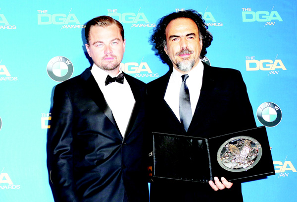 Director Alejandro Gonzalez Inarritu (right), recipient of the Feature Film Nomination Plaque for 'The Revenant', and actor Leonardo DiCaprio pose in the press room during the 68th Annual Directors Guild Of America Awards at the Hyatt Regency Century Plaza on Feb 6, in Los Angeles, California. (AFP)