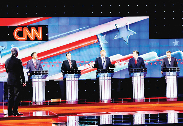 As Republican presidential candidate, businessman Donald Trump (center), speaks, Republican presidential candidates, retired neurosurgeon Ben Carson (left), Sen Marco Rubio, (second from left), Sen Ted Cruz (second from right) and Ohio Gov John Kasich (right), look on during a Republican presidential primary debate at The University of Houston, on Feb 25, in Houston. (AP)