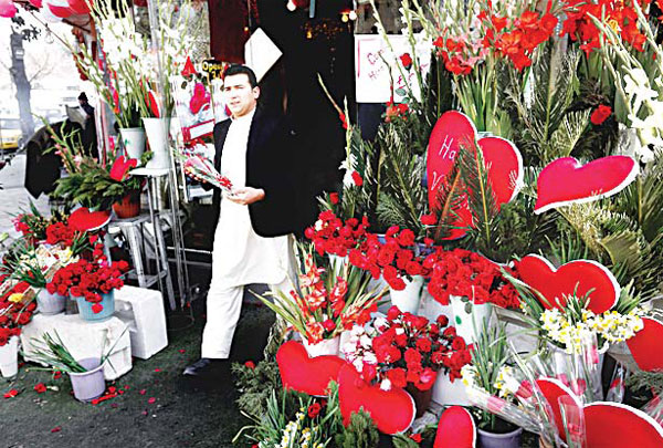 An Afghan man carries a bouquet of roses to celebrate Valentine's Day in Kabul, Afghanistan on Feb 14. (AP)