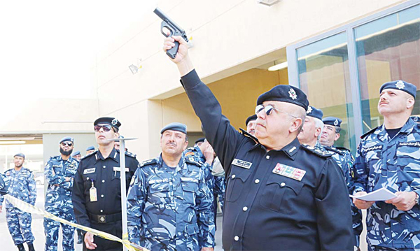 Lt Gen Sulaiman Al-Fahd fires a gun at the ceremony