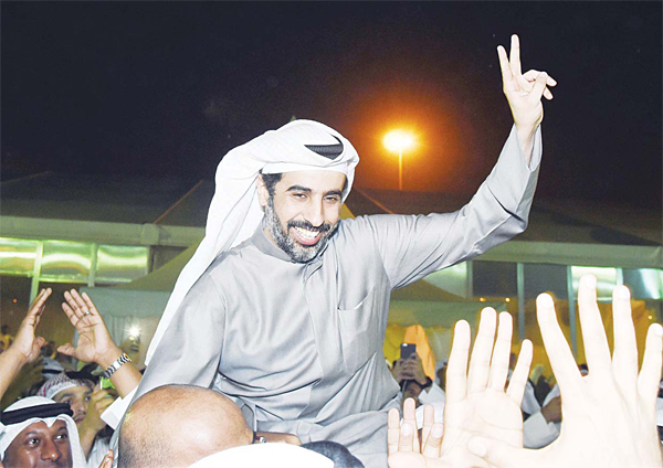 Newly-elected Member of Parliament Ali Abdullah Al-Khamis celebrates with supporters after winning Third Constituency by-election on Feb 20