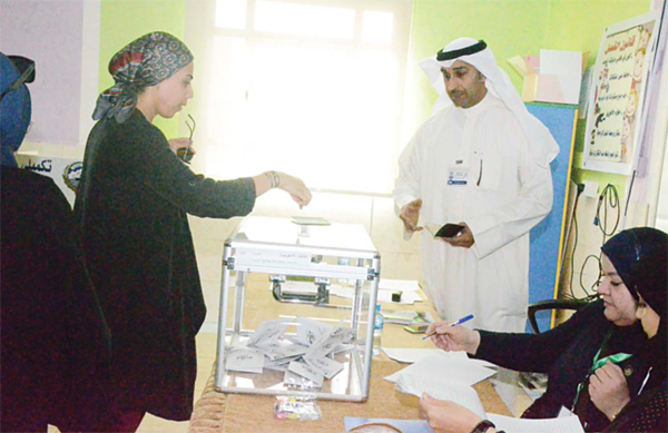 A woman casts her vote in the Third Constituency by-election held Saturday
