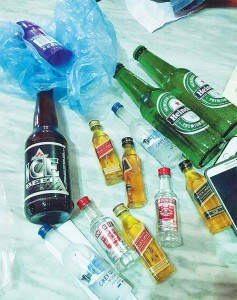 The liquor bottles seized from the three persons