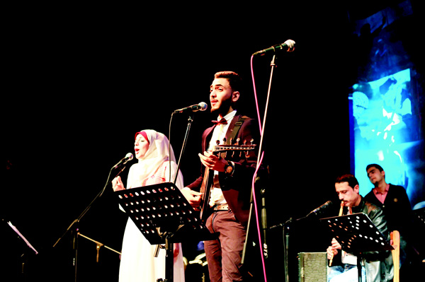 Palestinian members of the Dawaween music band, Raouf Belbeisi (right), and Rawan Okasha, play traditional oriental songs during a musical heritage concert in Gaza City on Feb 6. The Dawaween music band, founded three months ago by three musicians, counts now more than 40 members. (AFP)