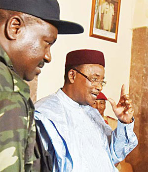 Niger's incumbent President Mahamadou Issoufou (right) gestures as he leaves the presidential palace in Niamey on Feb 26
