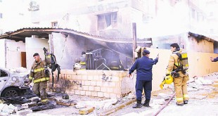 Senior MoI officials and firemen at the site of blaze