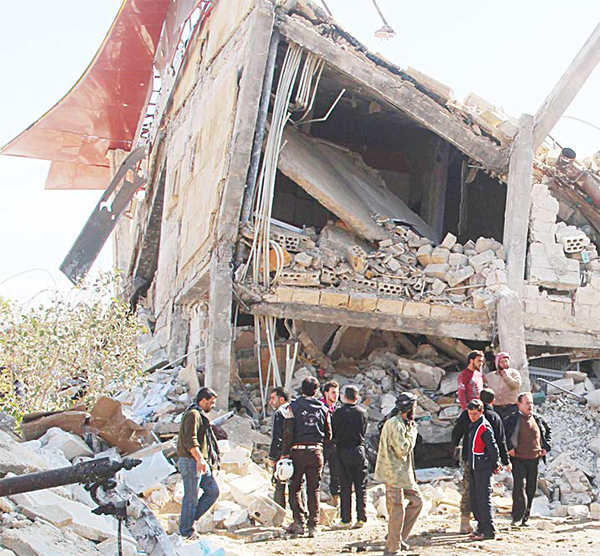 People gather around the rubble of a hospital supported by Doctors Without Borders (MSF) near Maaret al-Numan, in Syria's northern province of Idlib on Feb 15, after the building was hit by suspected Russian air strikes. MSF confi rmed in a statement that a hospital supported by the aid group in Idlib province was 'destroyed in air strikes'. (AFP
