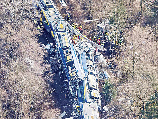 Aerial view shows firefighters and emergency doctors working at the site of a train accident near Bad Aibling, southern Germany on Feb 9. Two Meridian commuter trains operated by Transdev collided head-on near Bad Aibling, around 60 kms (40 miles) southeast of Munich, killing at least ten people and injuring around 100, police said. The cause of the accident was not immediately clear. (AFP)