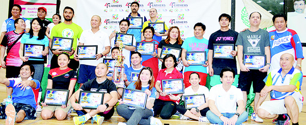 4 Feathers Badminton Championship Cup winners pose for a group photo.