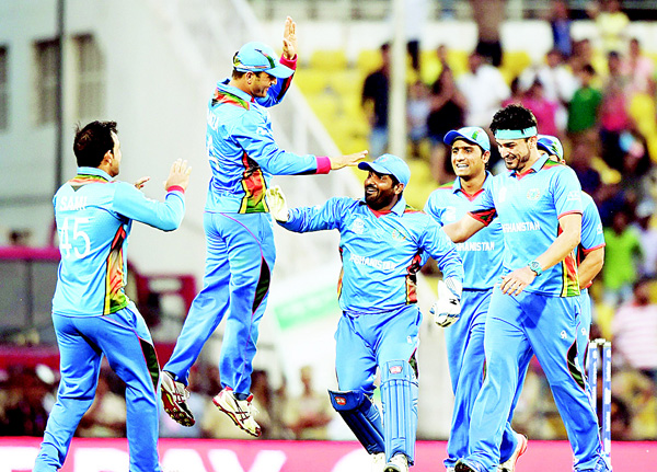 Afghanistan's players celebrate after the wicket of West Indies batsman Andre Russell during the World T20 cricket tournament match between West Indies and Afghanistan at The Vidarbha Cricket Association Stadium in Nagpur on March 27. (AFP)