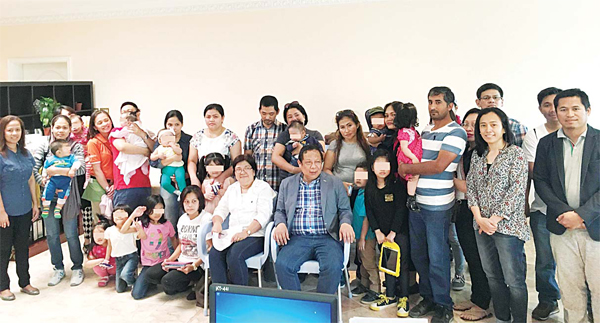 Ambassador Renato Villa (seated right) with the kids, parents and embassy officials.