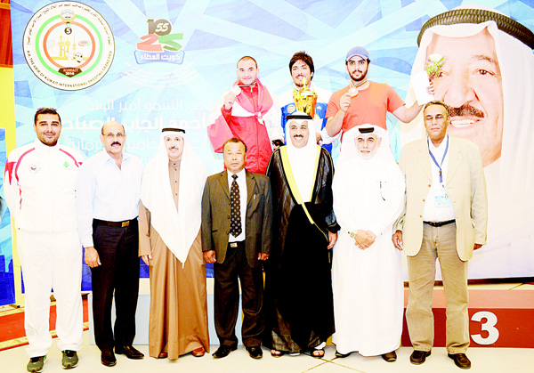 Winners, officials pose for a photo after the awarding.