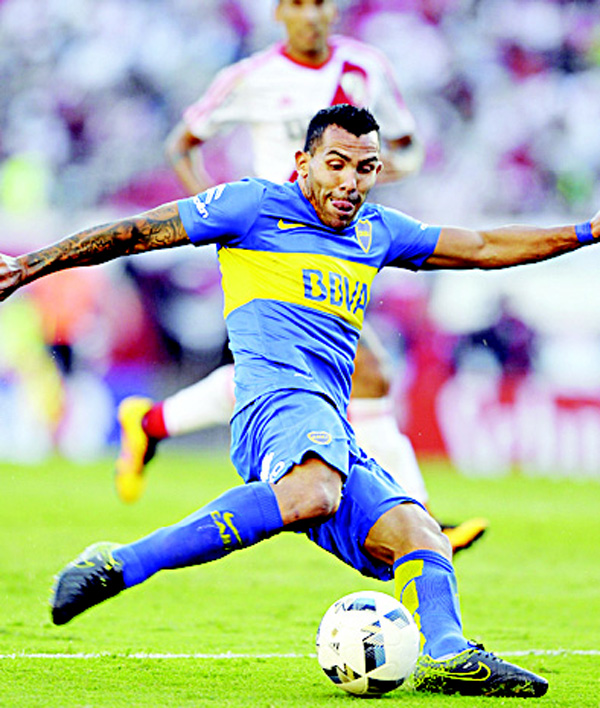 Boca Juniors' forward Carlos Tevez shoots the ball during their Argentina a First Division football match against River Plate at the Monumental Stadium in Buenos Aires on March 6. (AFP)
