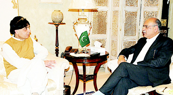 In this photo released by the Press Information Department, Pakistan Interior Minister Chaudhry Nisar Ali Khan (left), meets with Najam Sethi, Chairman of the Pakistan Cricket Board executive committee, in Islamabad on March 11. Khan allowed Pakistan cricket team to travel to India for the World Twenty20 tournament after officials of Indian government guaranteed the safety of Pakistan cricketers during the tournament. (AP)