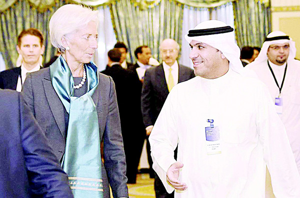 In this file photo, Dr Mohammad Al Hashel (right) welcomes IMF chief Christine Lagarde during Largarde's visit to Kuwait on Nov 13, 2015.