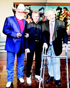 Fiddler Charlie Daniels (left), singer Randy Travis (center), and producer and label owner Fred Foster pose on March 29, in Nashville, Tennessee, after it was announced they will be inducted into the Country Music Hall of Fame. (AP)