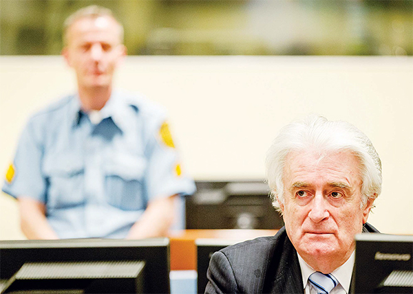 Bosnian Serb wartime leader Radovan Karadzic in the courtroom for the reading of his verdict at the International Criminal Tribunal for Former Yugoslavia (ICTY) in The Hague, The Netherlands on March 24. The former Bosnian Serb leader is indicted for genocide, crimes against humanity, and war crimes. (AP)