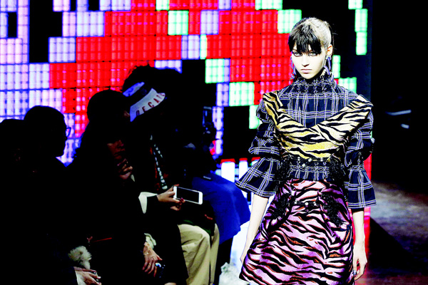 A model presents a creation for Kenzo 2016-2017 fall/winter ready-to-wear collection fashion show on March 8, in Paris. (AFP)