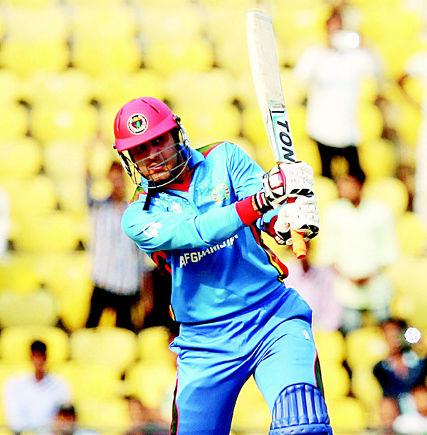 Afghanistan's Mohammad Nabi plays a shot during the T20 World Cup cricket match between Zimbabwe and Afghanistan at the VCA Stadium in Nagpur on March 12. (AFP)