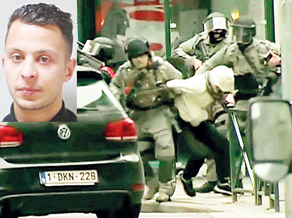 A screen grab from French television station RTL shows Salah Abdeslam (in a white hoodie) being dragged away from the scene by armed officers. (Inset) A mug shot of Abdeslam. (Agencies)