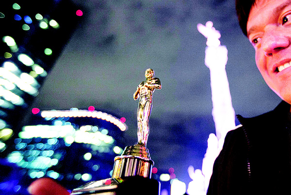 A fan holds a replica of an Oscar statuette as he celebrates with others the Oscar win for US actor Leonardo DiCaprio, who won in the Best Actor in a Leading Role category for 'The Revenant,' at the Angel of Independence monument, in Mexico City. The revelers were chanting in Spanish 'Leo, brother you are Mexican now!'