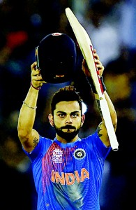India's Virat Kohli celebrates after victory in the World T20 cricket tournament match between India and Australia at the Punjab Cricket Association Stadium in Mohali on March 27. (AFP)